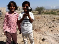After they escaped, children carry the remnants of a projectile and consider it a toy given to them by the Houthi militia